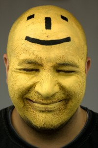 Creativity through laughter with painted yellow face