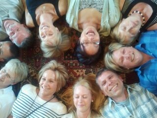 Smiling people enjoying Laughter Yoga in Devon
