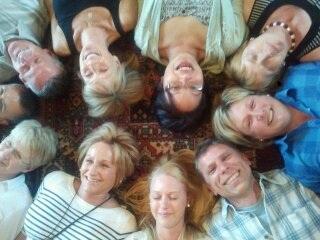 Smiling people enjoying Laughter Yoga in Devon