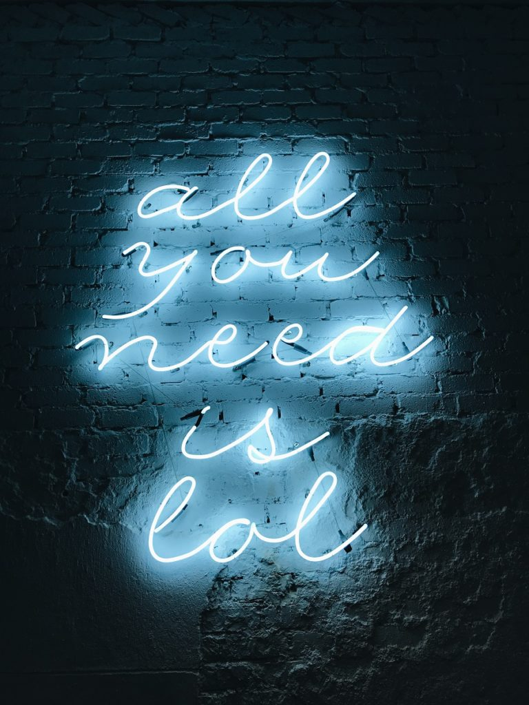 "neon lights ""all you need is LOL"" Laughing Yoga"